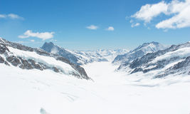 Snow capped Swiss Alps mountain at Jungfrau, Switzerland. Snow capped mountains view at Jungfrau viewpoint which is called Top of Europe in Switzerland Royalty Free Stock Images