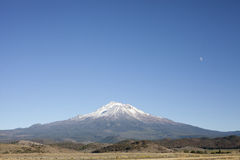 Snow capped volcano Stock Photography