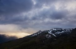 Sun breaks over Seven Devils Peaks stock photography