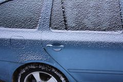 Snow on the car frozen central locking Royalty Free Stock Image