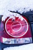 Snow on a car light Royalty Free Stock Photo