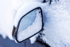 Snow on a car mirror Royalty Free Stock Photos