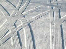 Snow car tracks abstract. Abstract design - tire tracks in snow in an Ottawa, Ontario street royalty free stock photo