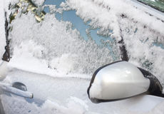 Snow on car Royalty Free Stock Images