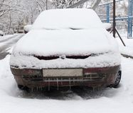 Snow on the car in the winter on the nature.  Stock Photos