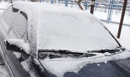 Snow on the car in the winter on the nature.  Royalty Free Stock Images