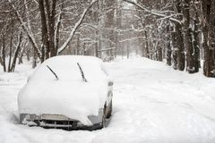 Snow on cars in park after snowfall. Winter urban scene.  stock photos