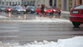 Snow and cars traffic and people Royalty Free Stock Image