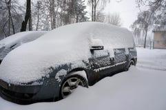 Snow on cars. Winter urban scene. Snow on cars after snowfall. Winter urban scene Royalty Free Stock Photography