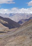 Snow carved valley and Karakoram mountains from Kh Stock Photos