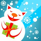 Snow cat with gift Royalty Free Stock Image
