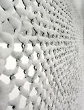 Snow caught on wire fence. Texture, pattern created by snow caught on a wire fence during a blizzard Royalty Free Stock Image