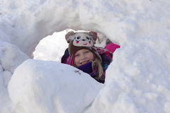 Snow Cave. Girl playing in snow cave Stock Photo