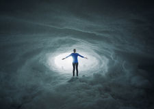Snow cavern praise. A woman lost in a snow cavern with her arms in praise royalty free stock photo