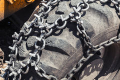 Snow chain over huge tractor wheel, closeup Stock Photography