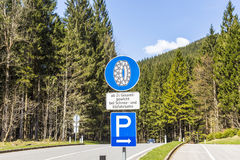 Snow chain sign with parking place to change Royalty Free Stock Photos