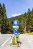 Snow chain sign with parking place to change Stock Image