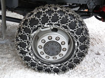 Snow chains. Big Snow chains on a big wheel Stock Photography