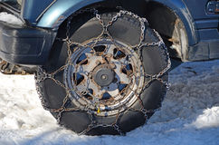 Snow chains. On the wheel Stock Photography