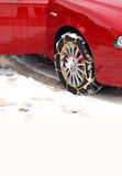 Snow Chains on a Car Tire. Sport Car with snow chains. Photo taken in the village of Canfranc, Huesca (SPAIN)near the ski stations of Candanchú and Astún Stock Photos