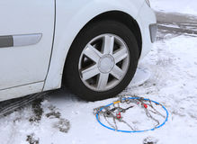 Snow chains in the car tyre in winter Stock Photography