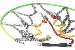 Snow chains for cars on the white background. Snow chains for cars on the white background Royalty Free Stock Photos