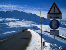 Snow chains necessary. Attention sign to use snow chains under snowy and icy conditions. Passo giovo, south tirol, italy royalty free stock image