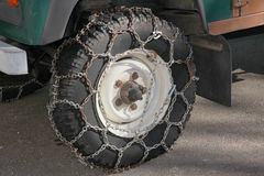 Snow chains on a pickup wheel Royalty Free Stock Photo