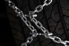 Snow chains on a tire Royalty Free Stock Photo