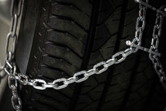 Snow chains on tire Royalty Free Stock Images