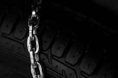 Snow chains on tire Royalty Free Stock Photography
