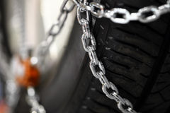 Snow chains on tire Royalty Free Stock Photo