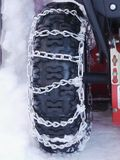 Snow chains tyre Stock Photos