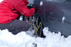 Snow chains on the wheels of car. Background royalty free stock photo