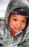 Snow Child. A gorgeous young boy is covered in snow as he plays outside Royalty Free Stock Images