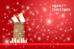 Snow and chrismas present on  chimney with gift boxes. On red background Royalty Free Stock Photography