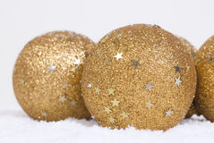 Snow and christmas ball. Snow and gold christmas balls with stars Stock Images