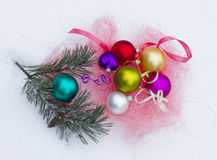 On snow Christmas colorful toys and pine branch Royalty Free Stock Image