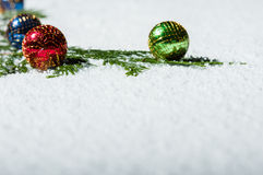 Snow and Christmas ornaments space for text Stock Images