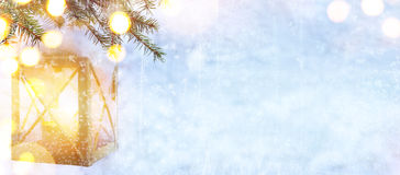 Snow Christmas tree and Holidays light on blue winter background Royalty Free Stock Images