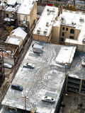 Snow on City Buildings Stock Photo