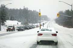 Snow in the city. Driving in severe weather conditions. Winter season stock images