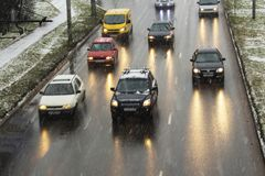 Snow in the city night traffic road transport.  Royalty Free Stock Image