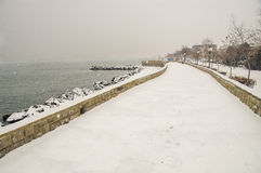 Snow on the city quay of Pomorie in Bulgaria Stock Photos