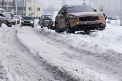 Snow city road rut, cleaning of snowy roads, dangerous driving royalty free stock photography