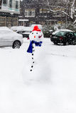 Snow in the city - Snowman Stock Photo