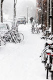 Snow in the city - snowstorm, streetview, bikes Royalty Free Stock Image