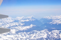 Snow clad French Alpes below Stock Images