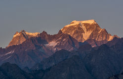 Snow clad Peak in Himalaya. Sunset over Snow clad mountain Peaks `Hathi and Ghori Paevat ` Indian Himalaya Stock Photos