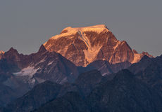 Snow clad Peak in Himalaya. Sunset over Snow clad mountain Peaks `Hathi Parvat` in Indian Himalaya Royalty Free Stock Photos